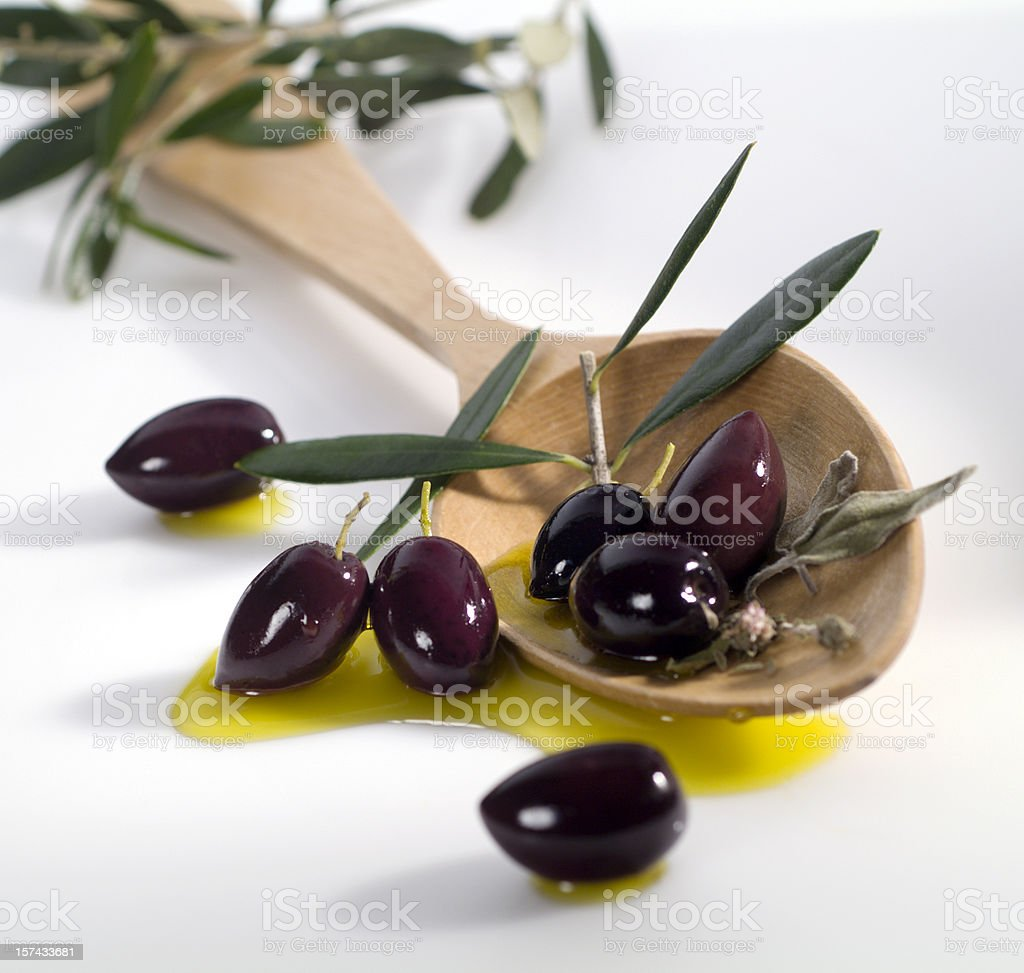 Black Calamata olives and a wooden ladle royalty-free stock photo