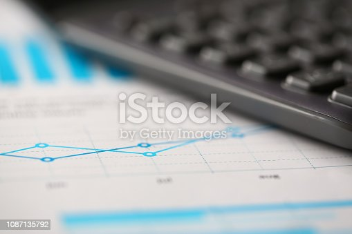 istock Black calculator and financial graph paper statistics 1087135792