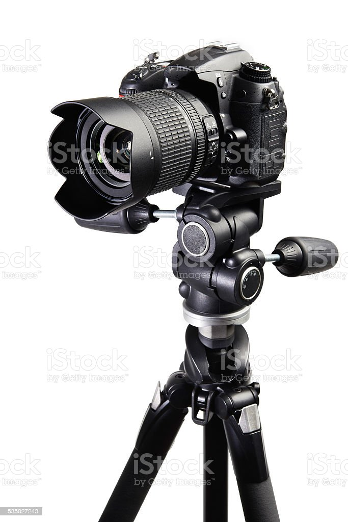 DSLR black camera on tripod stock photo
