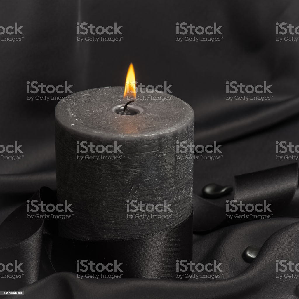Black candle which burns stock photo