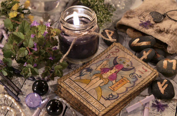 Black candle with the tarot cards and runes stock photo
