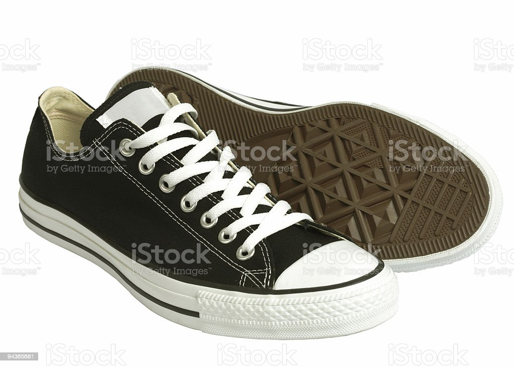 Black canvas sneakers, isolated, clipping path stock photo