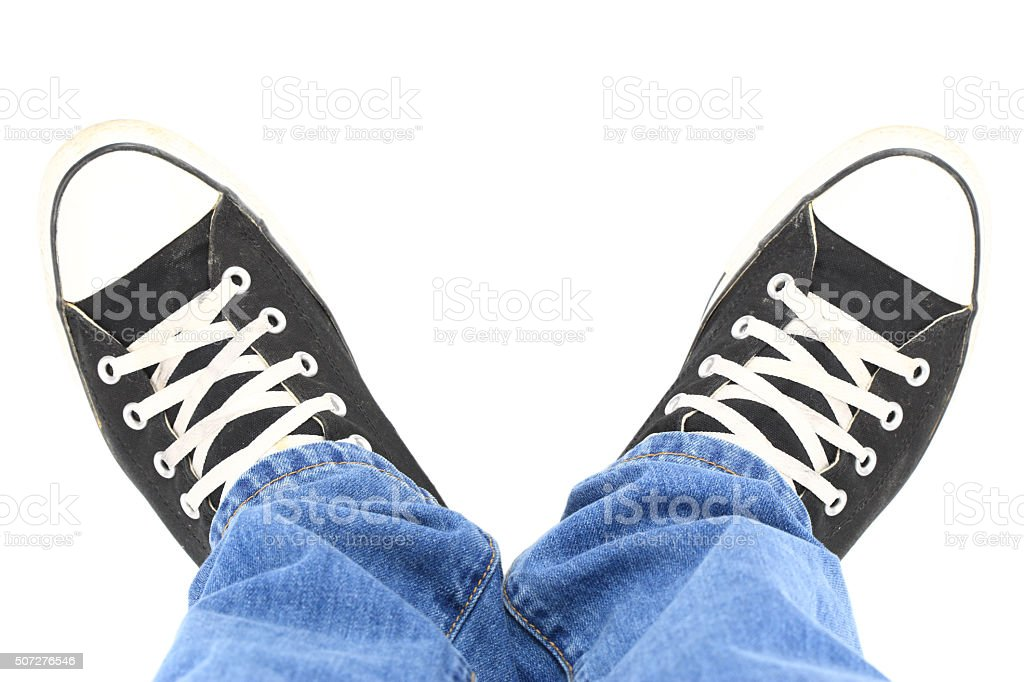 Black canvas sneakers, top view stock photo