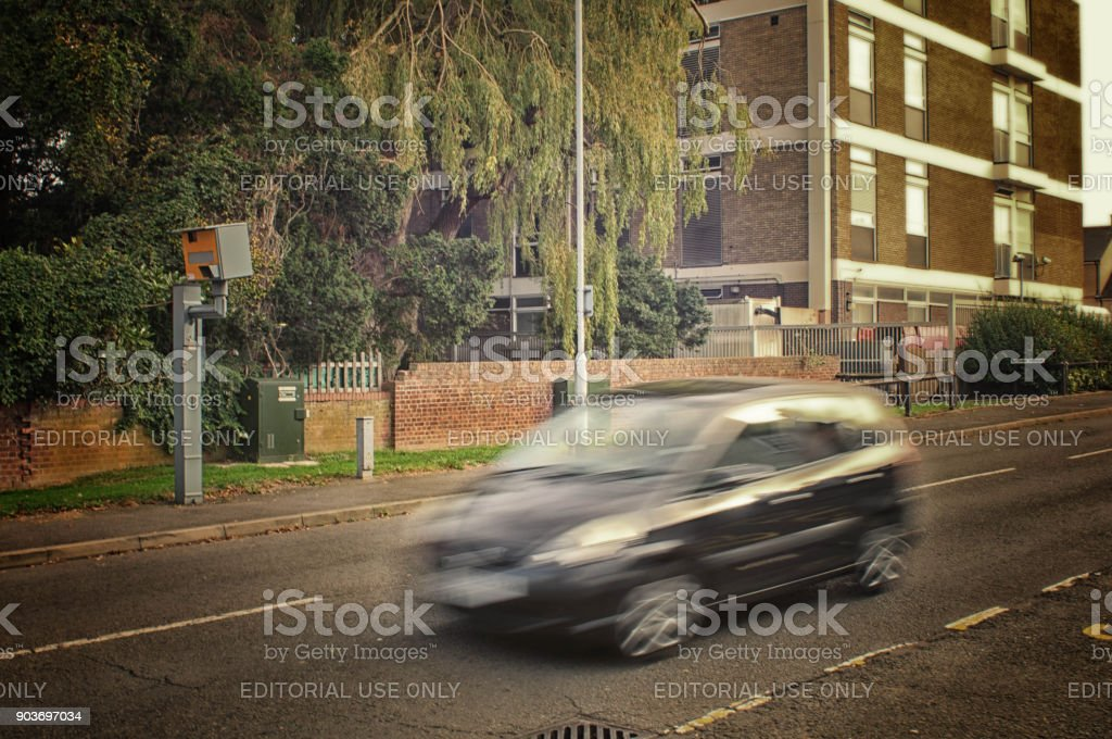 Black car and speed camera stock photo