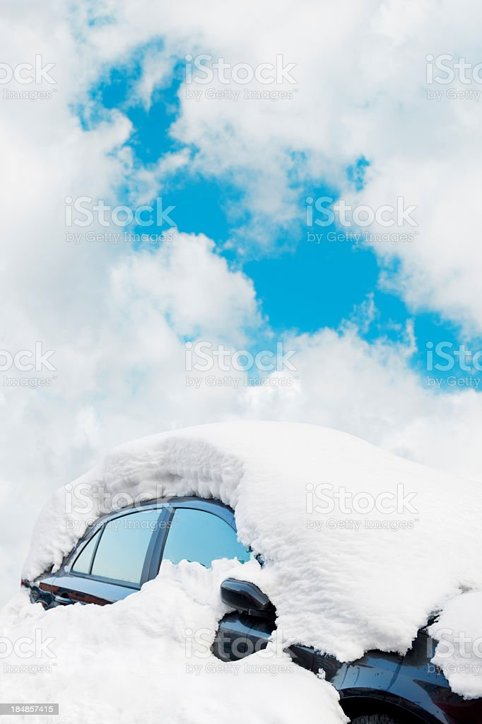 Black car covered in a thick layer of snow royalty-free stock photo