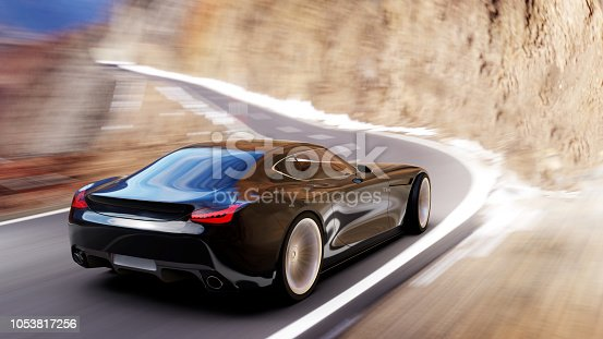 istock black car driving on a mountain road 1053817256
