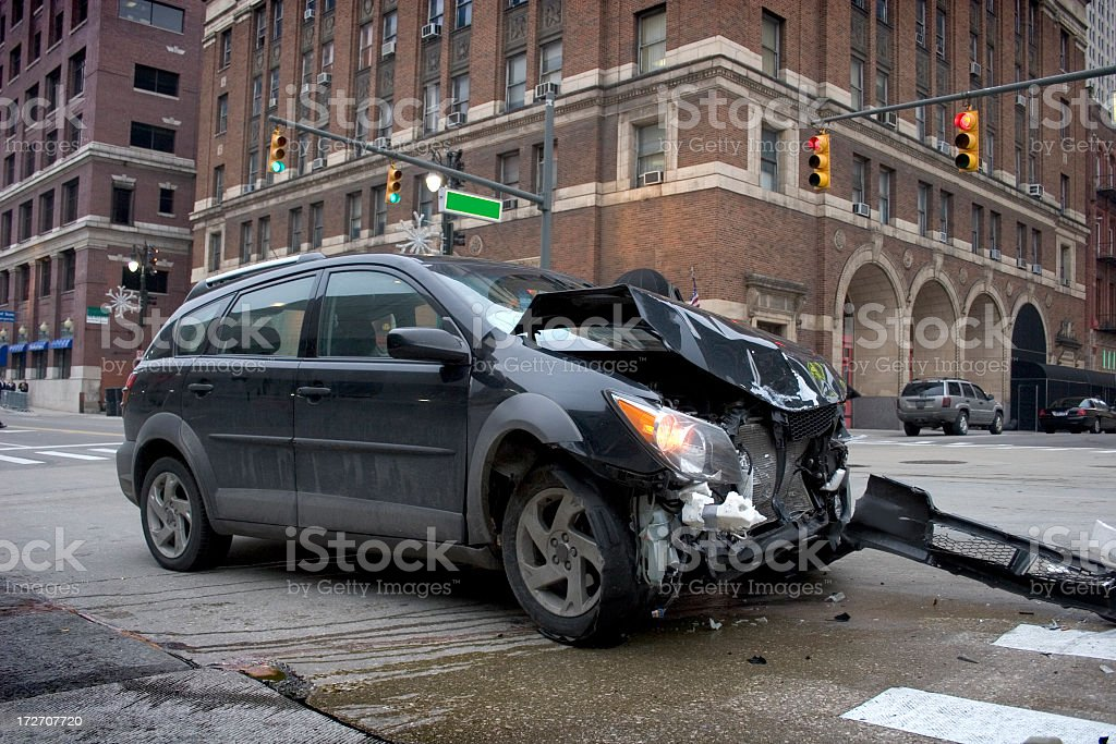 Black car with a smashed front in an intersection royalty-free stock photo