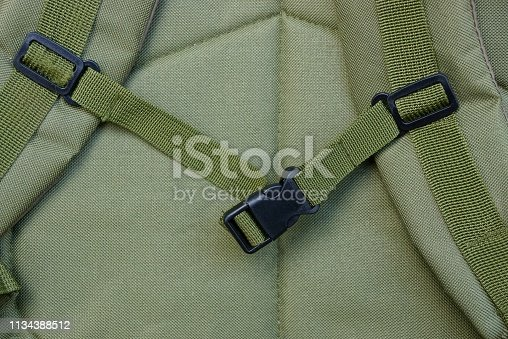 istock black carbine latch on the harness on the green matter of the backpack 1134388512