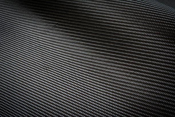 Fibra di carbonio nero sfondo di materiale composito - foto stock