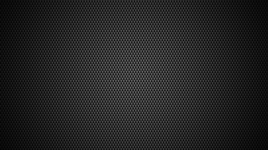 Black carbon fiber texture background. Sports race wallpaper.