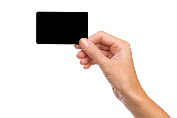 Black card in woman's hand stock photo