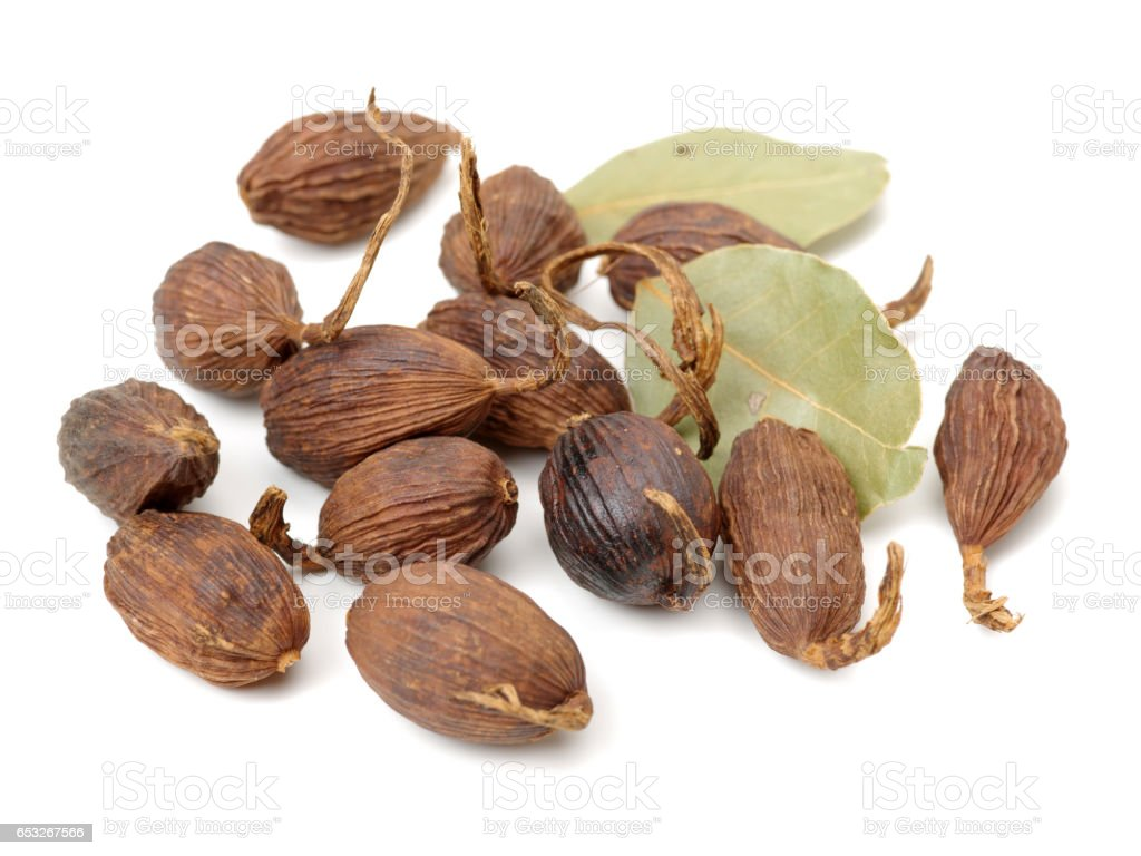 Black cardamom ,Aromatic bay leaves on a white background stock photo