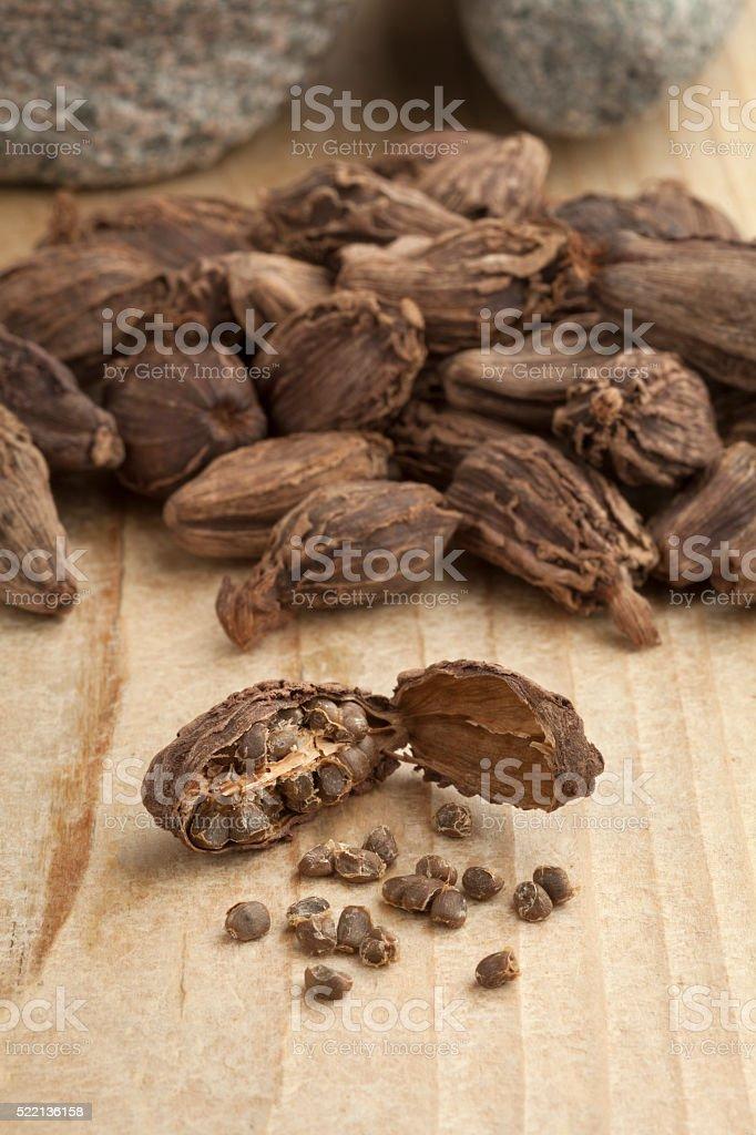 Black cardamom fruit and seeds stock photo