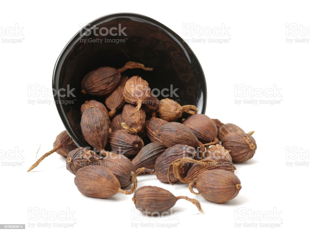 Black cardamom on a white background stock photo