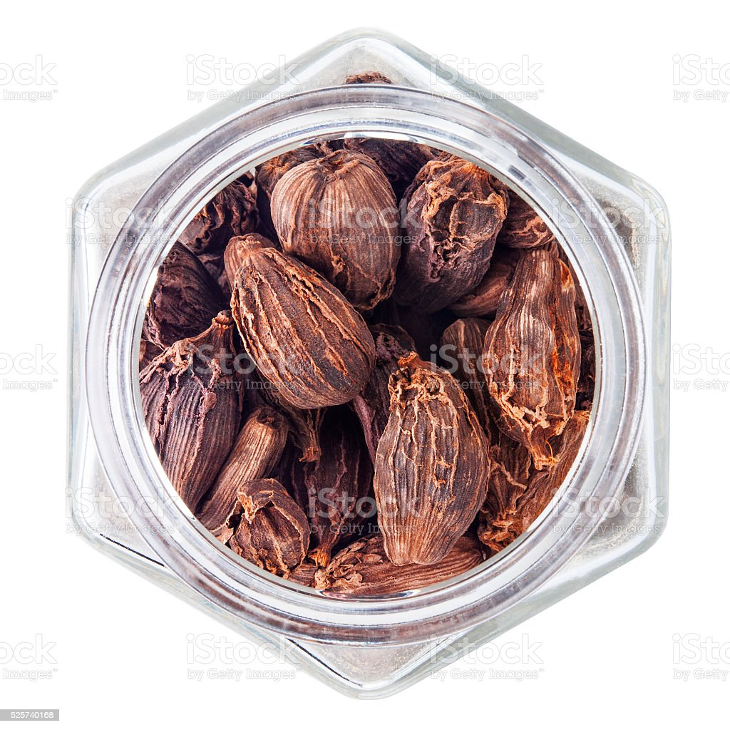 Black cardamom pods on white background stock photo