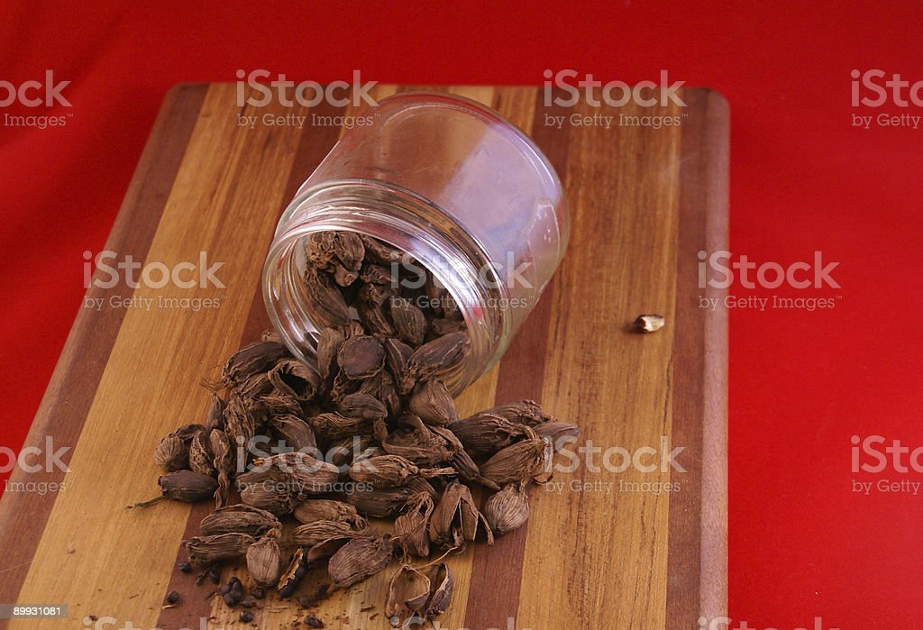 Black cardamon pods and seeds royalty-free stock photo