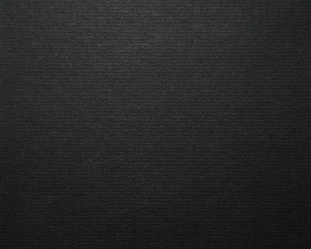 Black cardboard paper background stock photo