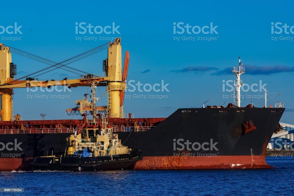 Black cargo ship stock photo