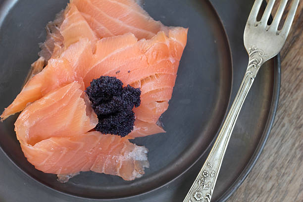 Black caviar and smoked salmon. stock photo