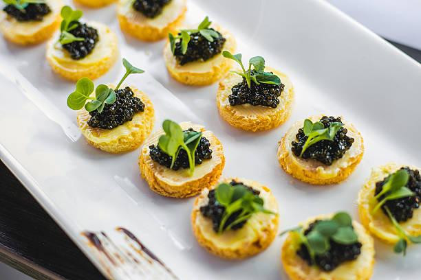 Black caviar appetizers - Photo