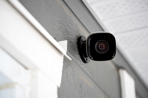 Black cctv outside the building, home security system