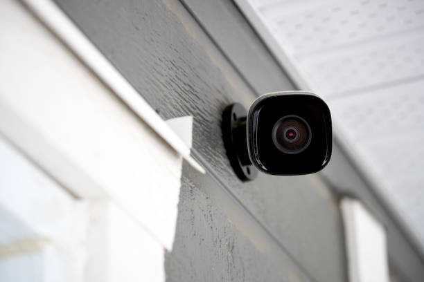 Black cctv outside building, home security system stock photo