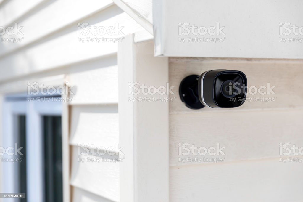 Black cctv outside the building, home security system stock photo