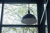 Black ceiling lamp in a cafe and with clear glass walls.