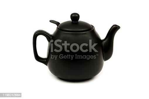 Black ceramic teapot for tea Isolated on a white background. Black teapot for tea on a white background.