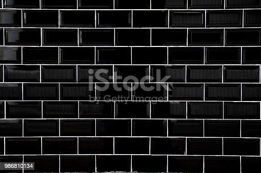istock Black ceramic tiles, Wallpaper and background concept. 986810134