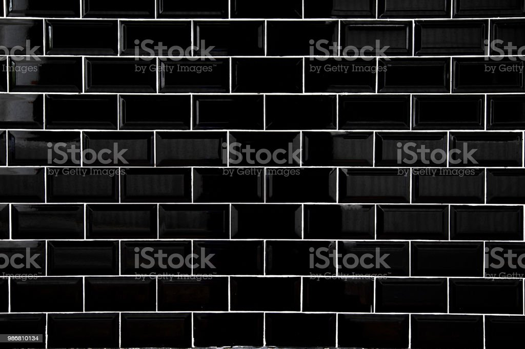 Black ceramic tiles, Wallpaper and background concept. stock photo