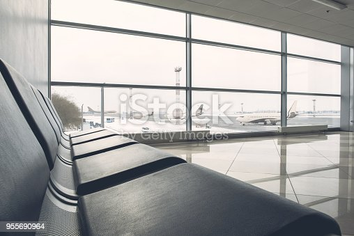 istock Black chairs situating in airport 955690964