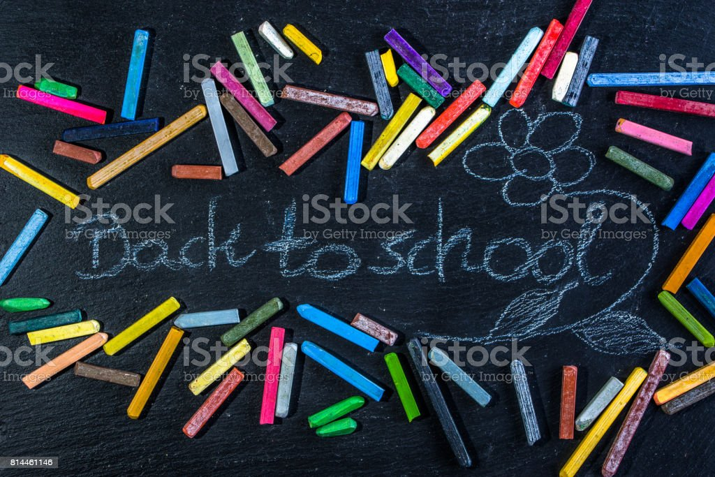 Black Chalkboard with back to school text written with white chalk on blackboard, start of education after summer holidays stock photo