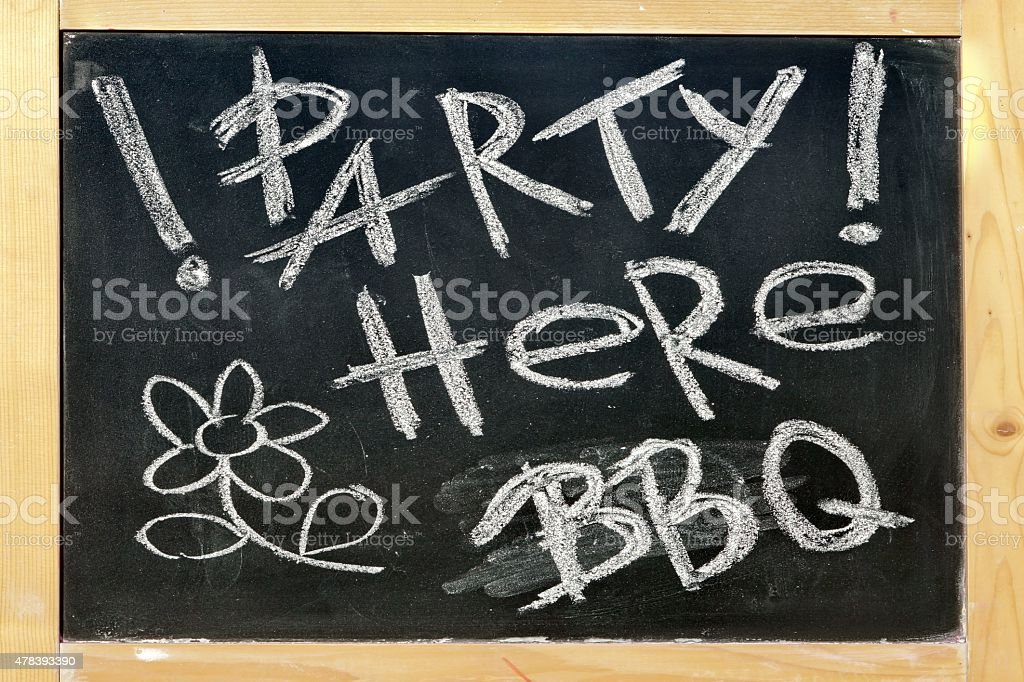 Black Chalkboard With Handwritten Sign Party Here BBQ stock photo