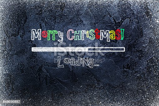 istock Black chalkboard with loading bar and Merry Christmas drawn on it 848695892