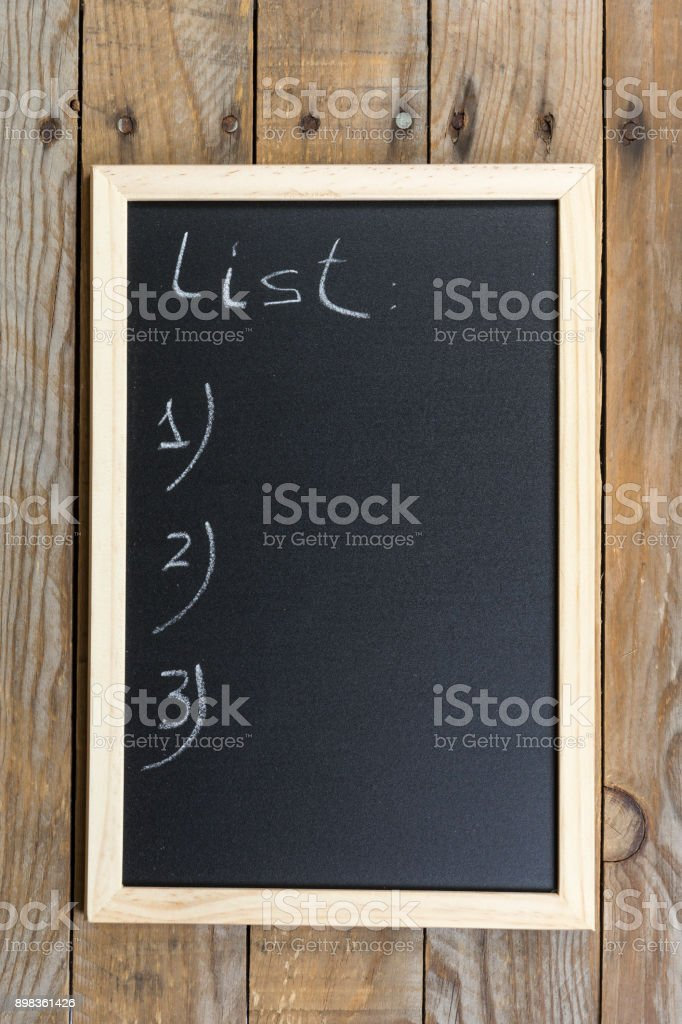 Black chalkboard with wooden frame. Space chalkboard background texture with wooden frame for notes and lists. blackboard space for wallpaper. Landscape mounting style vertical. Advertisement Stock Photo