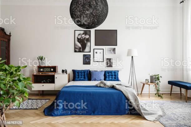 Black chandelier in navy blue bedroom in tenement house floor lamp picture id1146763125?b=1&k=6&m=1146763125&s=612x612&h=l5 4w92krigflmfr9kuwtkufc2ms8ktjdjny5mtbzxe=