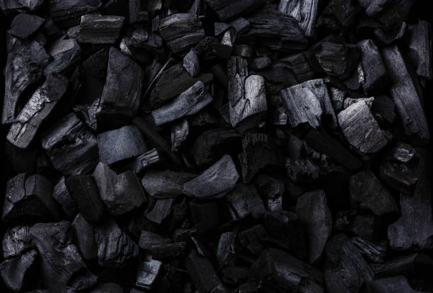 black charcoal background - coal stock pictures, royalty-free photos & images