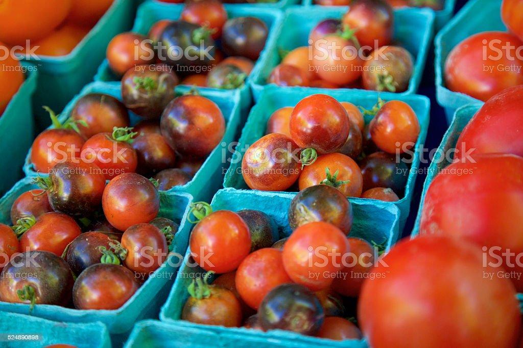 black cherry tomatoes stock photo