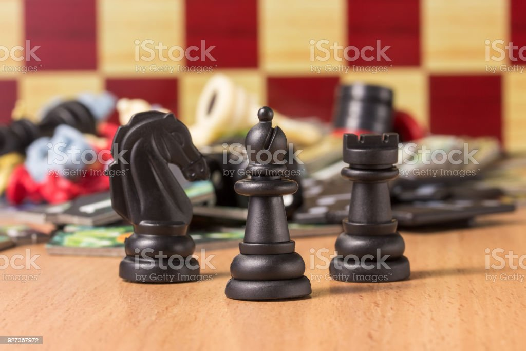 black chess bishop at the head of other figures on a blurred background of objects for table games - Royalty-free Bishop - Chess Piece Stock Photo