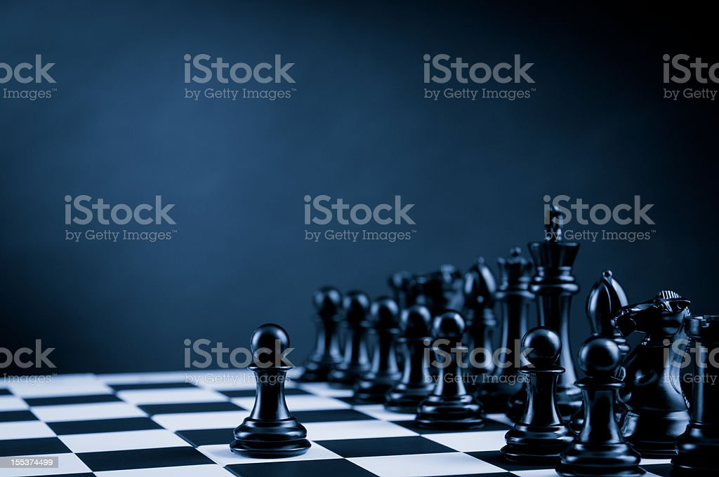 Black Chess Pawn on chessboard, leader and team royalty-free stock photo