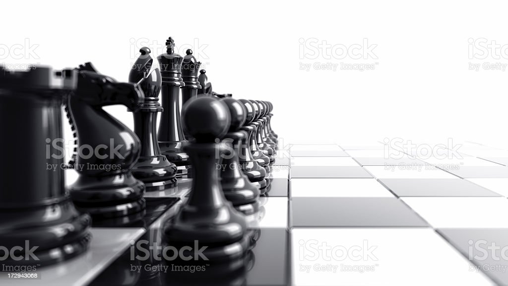Black chess pieces aligned on the left side of the board royalty-free stock photo