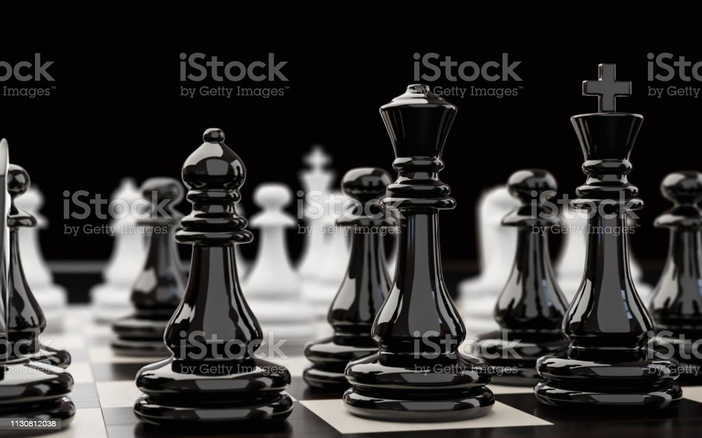 Black chess pieces extremely close up stock photo
