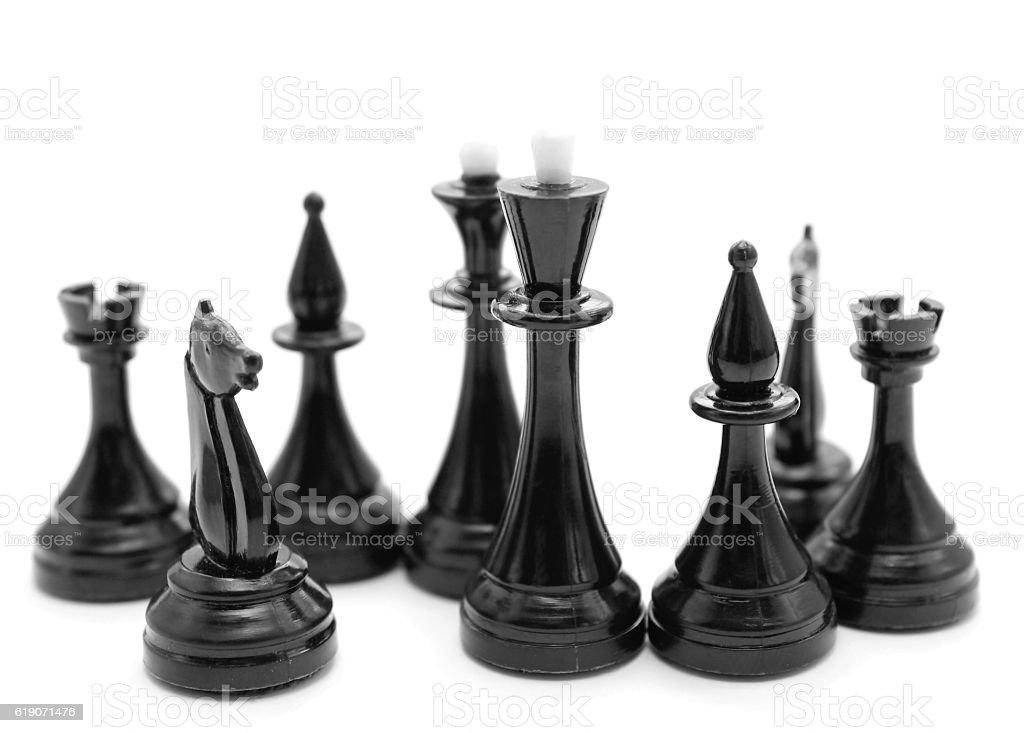 black chess pieces on white background stock photo