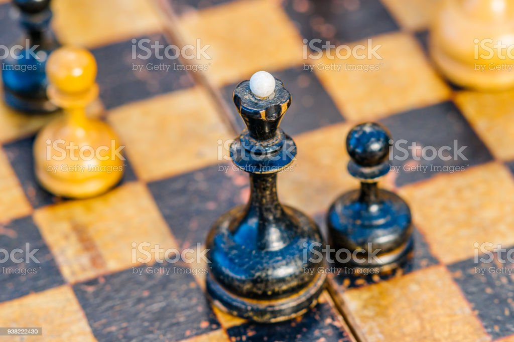 Black chess queen and a pawn stock photo