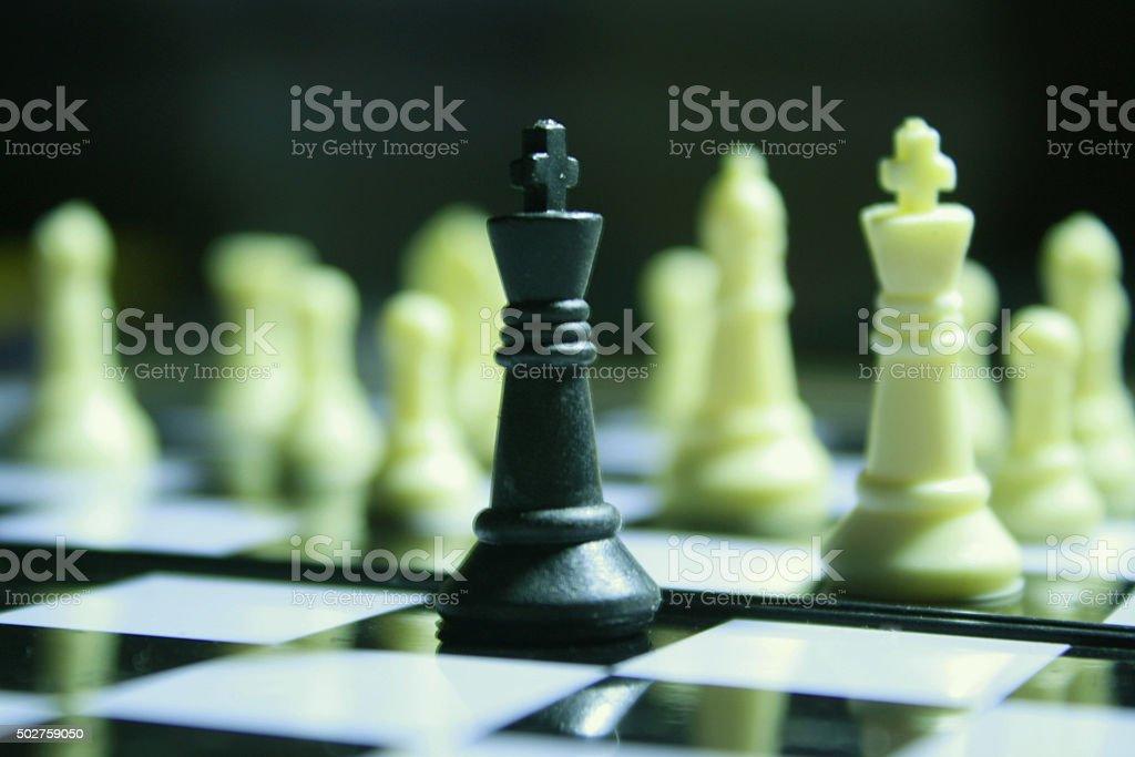 Black chessman alone fight stock photo