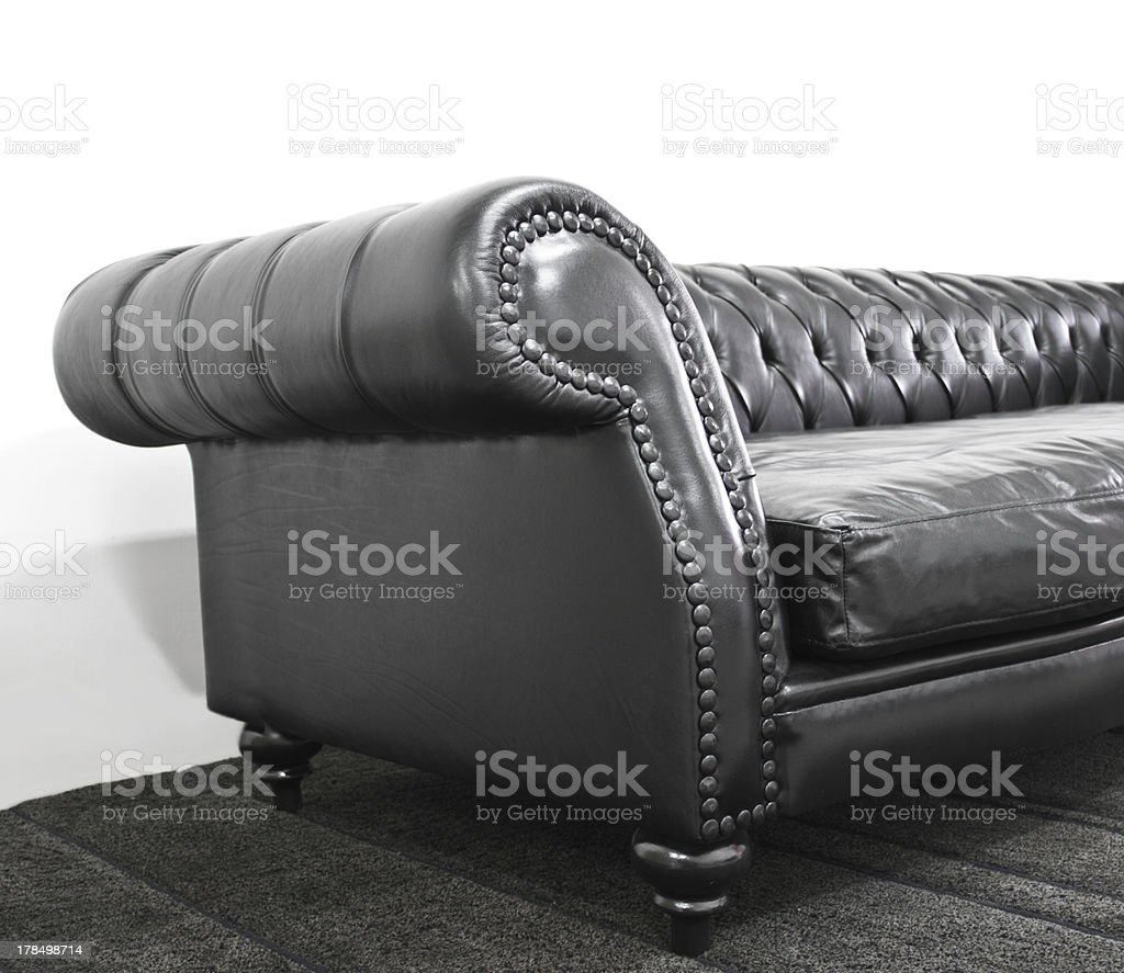 Black chesterfield leather sofa stock photo