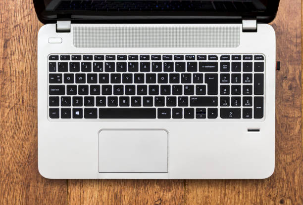 Black chiclet keyboard on silver laptop stock photo
