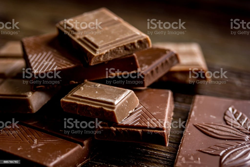 black chocolate close up on wooden background royalty-free stock photo