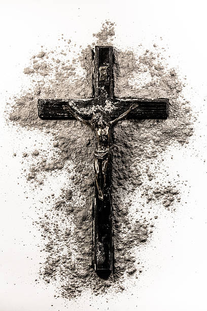 black christian cross covered in ashes - ash cross stock photos and pictures